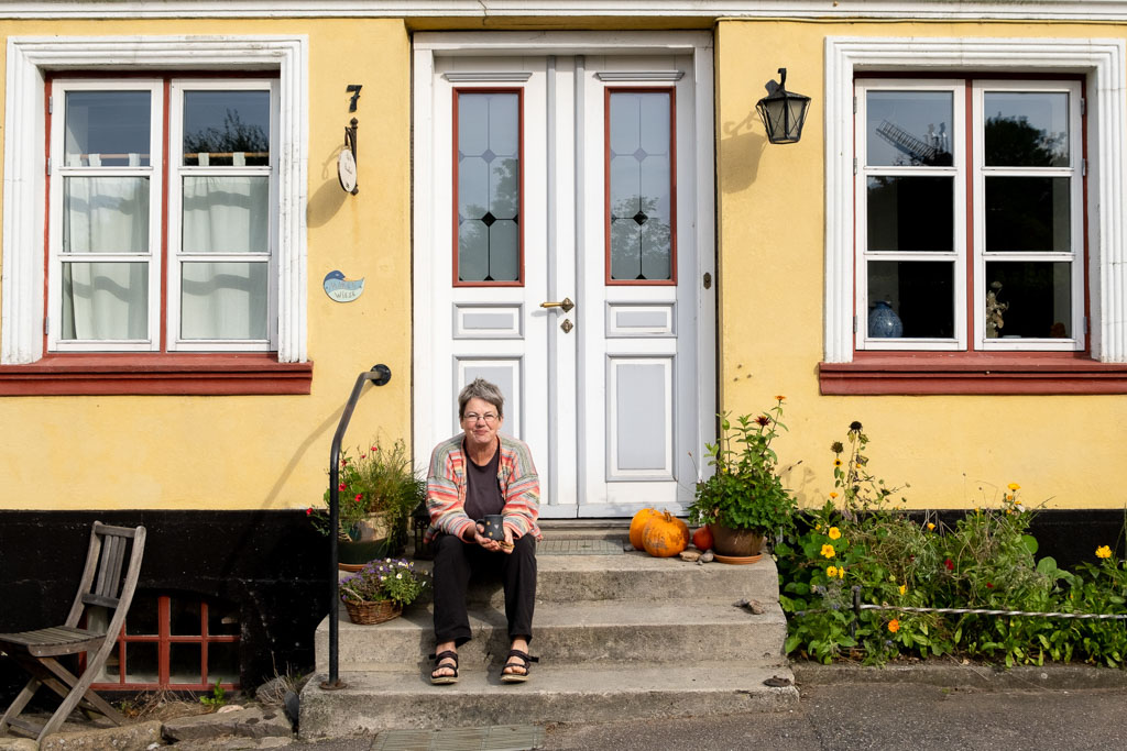 Maren in front of house